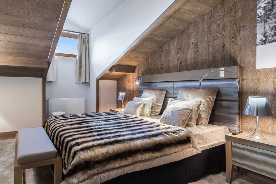 Résidence hôtelière Courchevel - photo de la chambre avec un lit conformable
